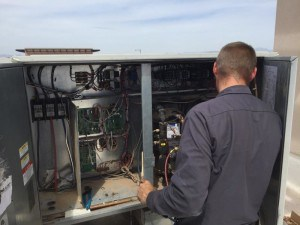 Northern Air technician working on a HVAC system in Phoenix AZ