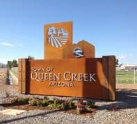 Road sign text, The Town of Queen Creek