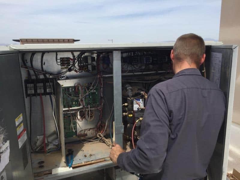 Northern Air technician working on a HVAC system in Phoenix AZ